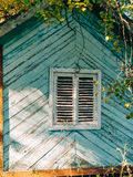 White window shutters. The facade of houses. In Montenegro Royalty Free Stock Image