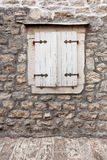 White window shutters at old building Stock Images