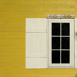 White window on wooden yellow wall Stock Photo