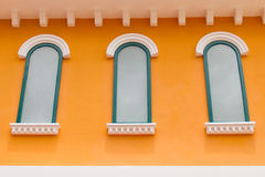 White window on a yellow wall Royalty Free Stock Photo