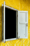 White window on yellow wall Royalty Free Stock Image
