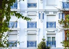 White windows, blue railings Stock Photo