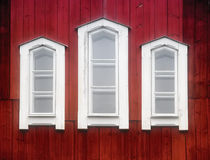 White windows on an old red church wall Royalty Free Stock Photo