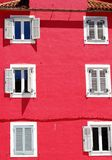 White windows on red wall Royalty Free Stock Images