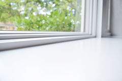 White windowsill. Surface or table with window in background, side angle. Use this as a background stock photos
