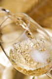 White wine. Is poured from a bottle Royalty Free Stock Images