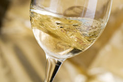 White wine. Is poured from a bottle stock photography