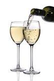 White wine. Poured into glass on white background royalty free stock photos