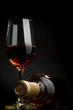 White wine. Bottle and glass of white wine on a dark background Royalty Free Stock Photography