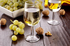 White wine. With grapes and walnuts Stock Image