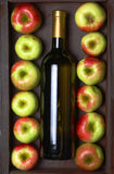 White wine and apples Stock Photography