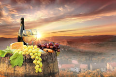 White wine with barrel on vineyard in Chianti, Tuscany, Italy. White wine with barrel on famous vineyard in Chianti, Tuscany, Italy Royalty Free Stock Image
