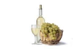 White wine. Basket of grapes italian wine Stock Photography