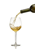 White wine being poured into wine glass Royalty Free Stock Image