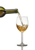 White wine being poured into wine glass on white. Background Stock Image