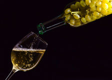 White wine. Being poured into a wineglass Stock Photography