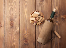 White wine bottle, bowl with corks and corkscrew. View from abov Stock Photography