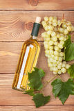 White wine bottle and bunch of white grapes Stock Photo