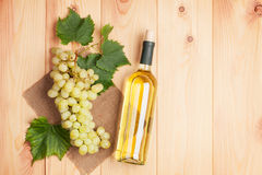 White wine bottle and bunch of white grapes Stock Image