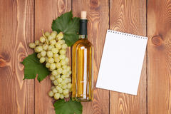 White wine bottle and bunch of white grapes Stock Photos