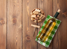White wine bottle, corks and corkscrew Royalty Free Stock Photography