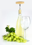 White wine bottle, corkscrew, wineglass, and grapes. Royalty Free Stock Photography