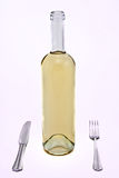 White wine bottle with fork and knife Stock Images