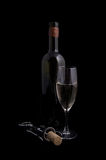 White wine bottle and glass with corkscrew Stock Photo