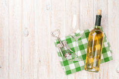 White wine bottle, glass and corkscrew Royalty Free Stock Images