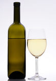 White wine bottle and glass. Isoleted in background Royalty Free Stock Photography