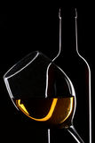 White wine bottle and glass silhouette Stock Photos