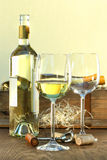 White wine bottle and glasses with crate Stock Photo