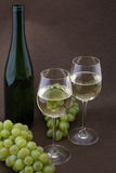 White wine with bottle, glasses and grapes Royalty Free Stock Image