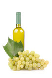 White wine bottle and grapes. Isolated on white background Stock Photo