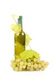 White wine bottle and grapes. Isolated on white background Stock Images