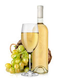White wine bottle and grapes in basket Stock Images
