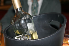 White wine bottle in an ice bucket Stock Image