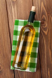 White wine bottle over towel on wooden table Stock Photo
