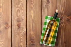 White wine bottle over towel on wooden table Stock Images