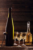 White wine bottle and wine glass on wooden vintage background Royalty Free Stock Image