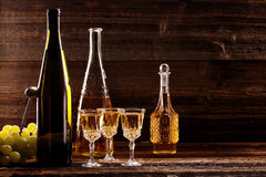 White wine bottle and wine glass on wooden vintage background Stock Photography