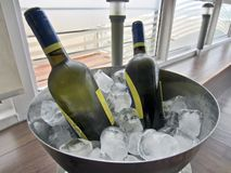 White wine bottles in ice Royalty Free Stock Photography