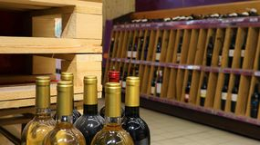 White wine in bottles in wine shop. Red and royalty free stock photography
