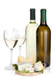 White wine bottles, two glasses and cheese Royalty Free Stock Photography