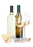 White wine bottles, two glasses, cheese and corkscrew Royalty Free Stock Image