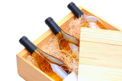 White Wine Bottles in wooden crate Stock Photo