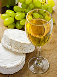 White wine, Brie, Camembert and grape Royalty Free Stock Photography
