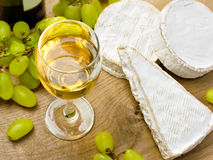 White wine, Brie, Camembert and grape Stock Image