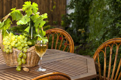 White wine and bunch of grapes stock images