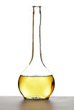 White wine carafe. White wine in a nice shaped bottle with white background Royalty Free Stock Photos